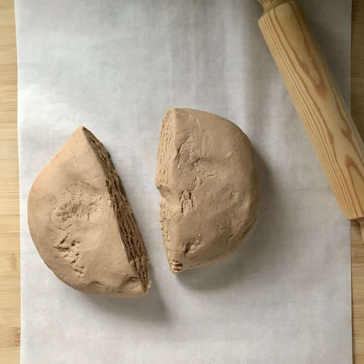 Biscotti dough on parchment paper.