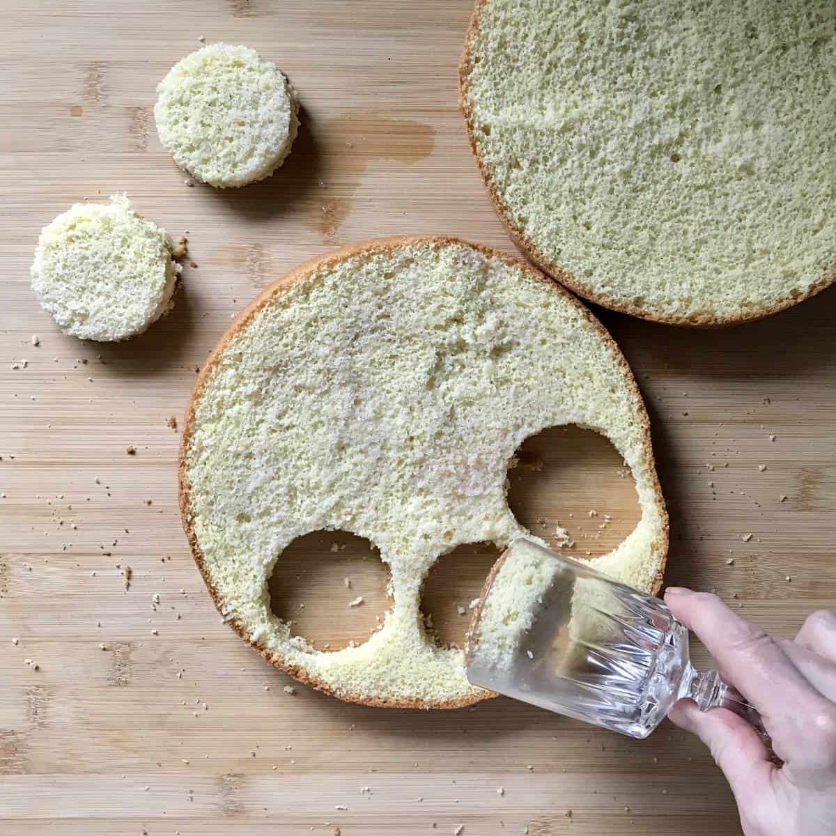 Round pieces of cake being formed with a glass.