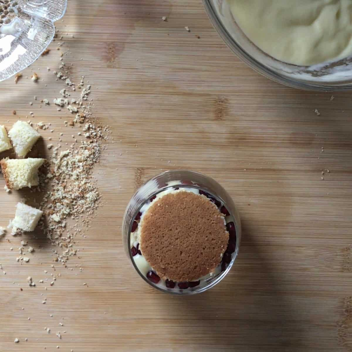 Top round piece of sponge cake for an individual trifle in a glass.