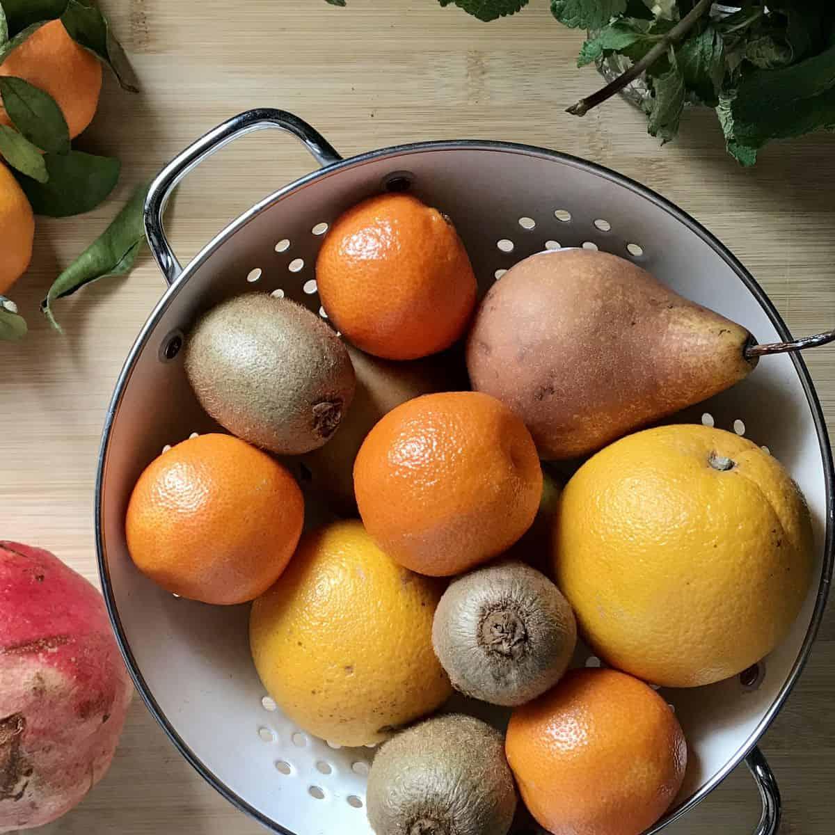 Winter fruits in a colander.