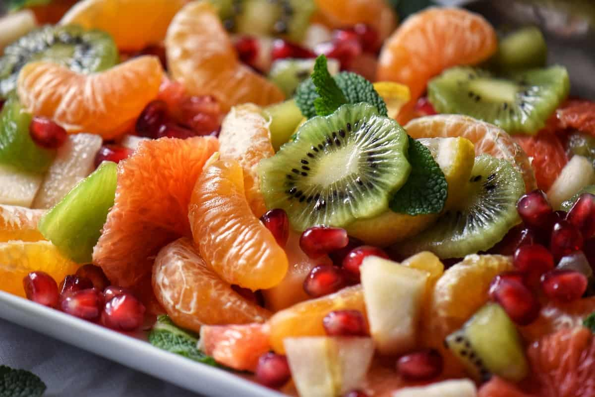 A close up photo of the sliced and diced fruit used in a winter fruit salad.