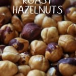 Roasted hazelnuts on a baking sheet.