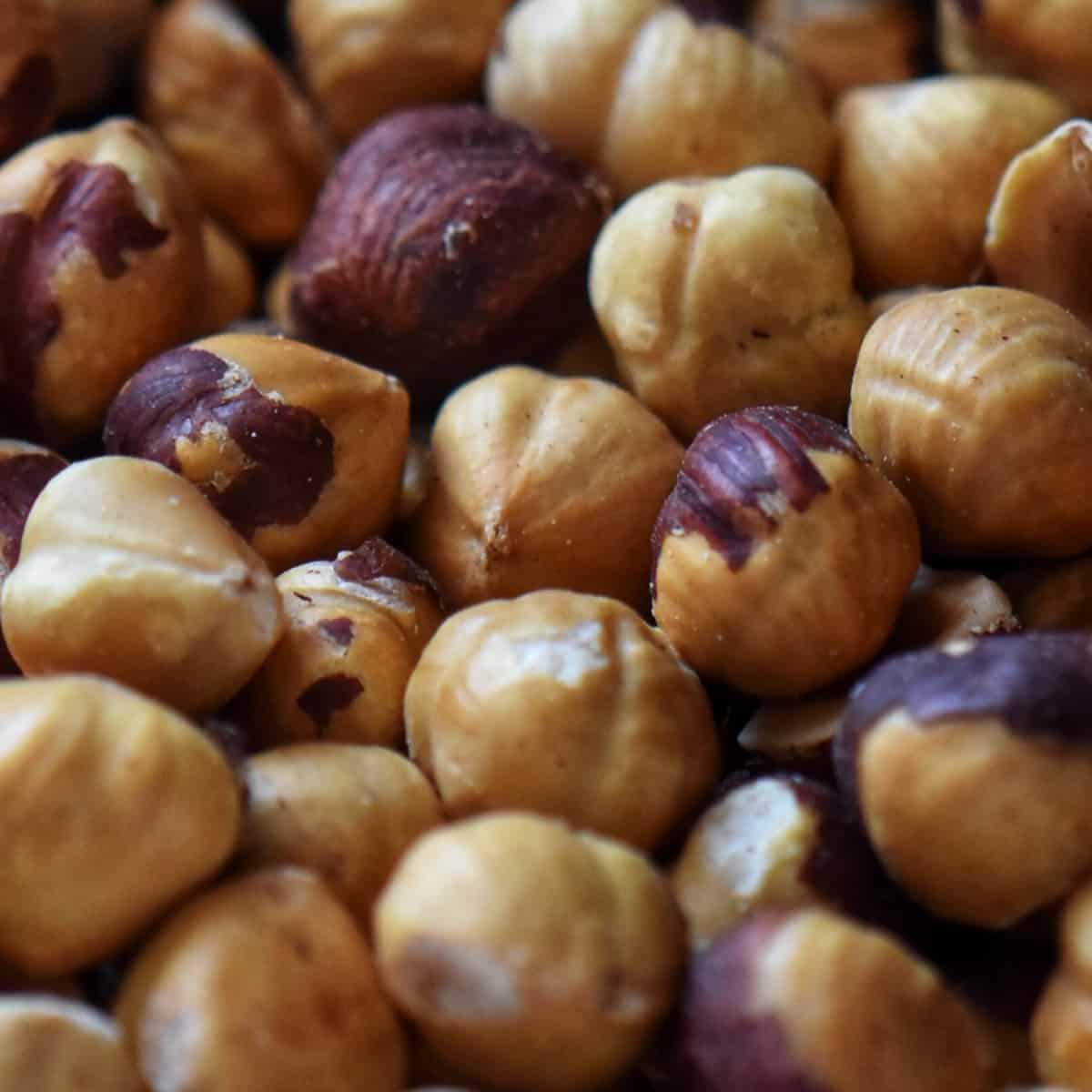 A close up of roasted hazelnuts.