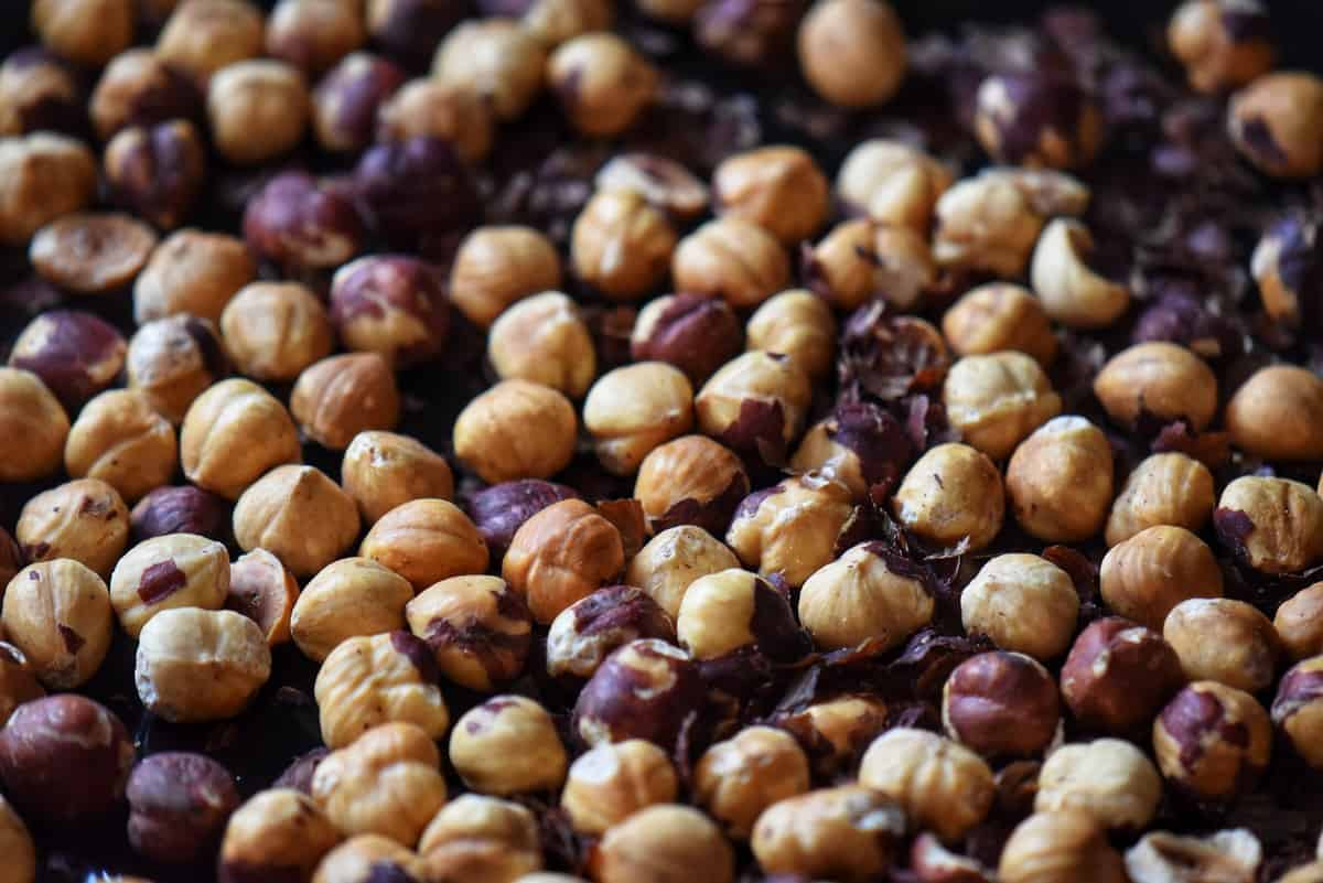 Roasted hazelnuts on a sheet pan.