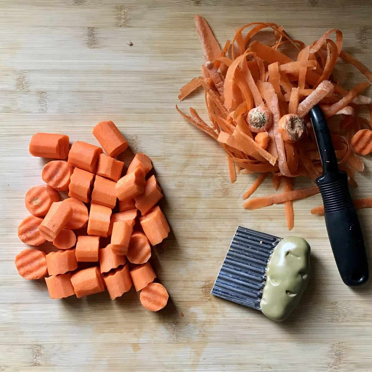 Crinkle cut carrots on a wooden board.