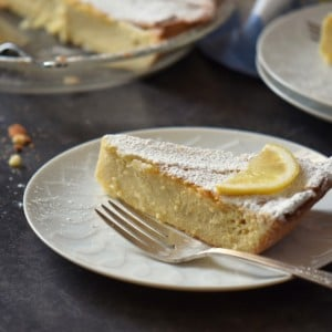 A slice of ricotta pie on a white plate.