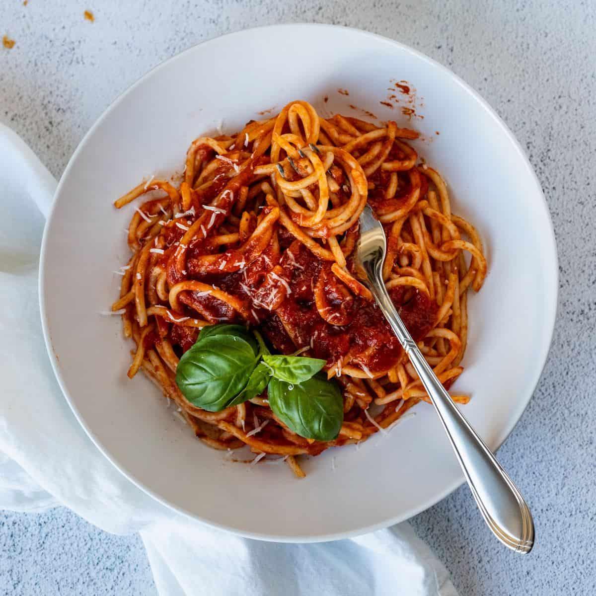 Spaghetti in a white plate.