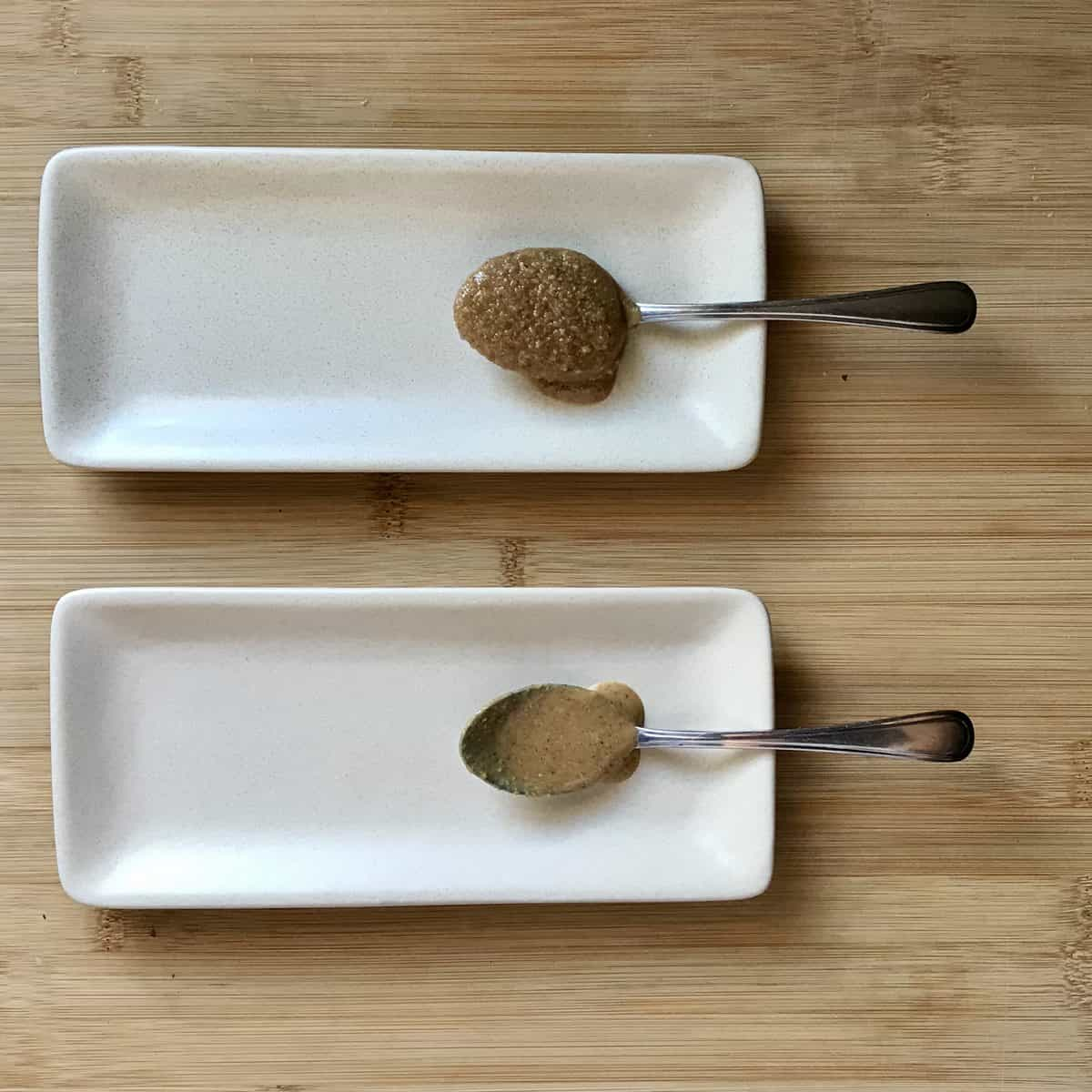 Spoonful of nut butter on a white plate.