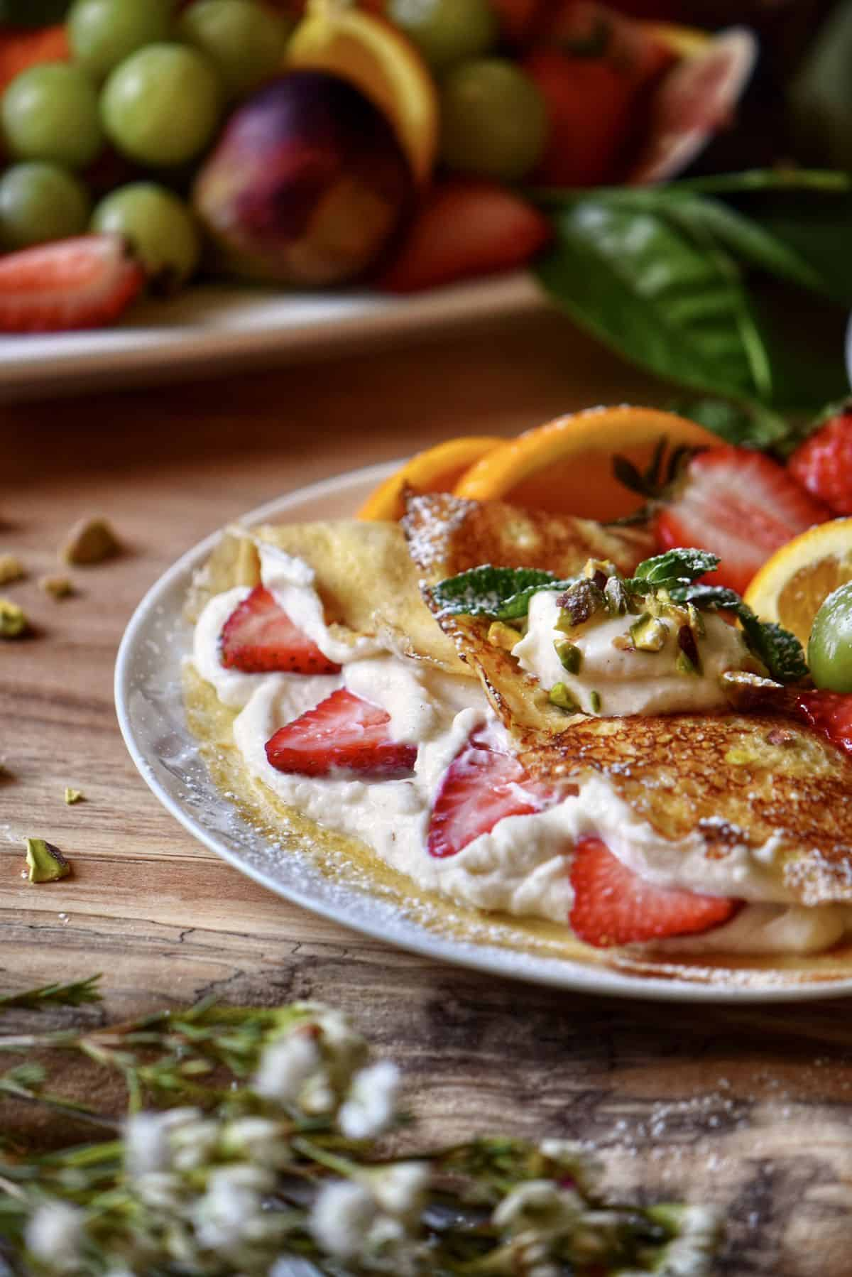 Ricotta filled crepes with strawberries.