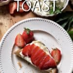 Ricotta toast garnished with slices strawberries.