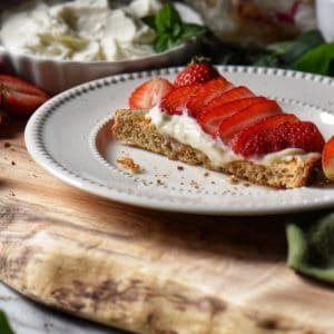 Ricotta toast on a white plate.