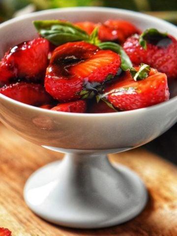 Balsamic Glazed Strawberries in a white bowl.