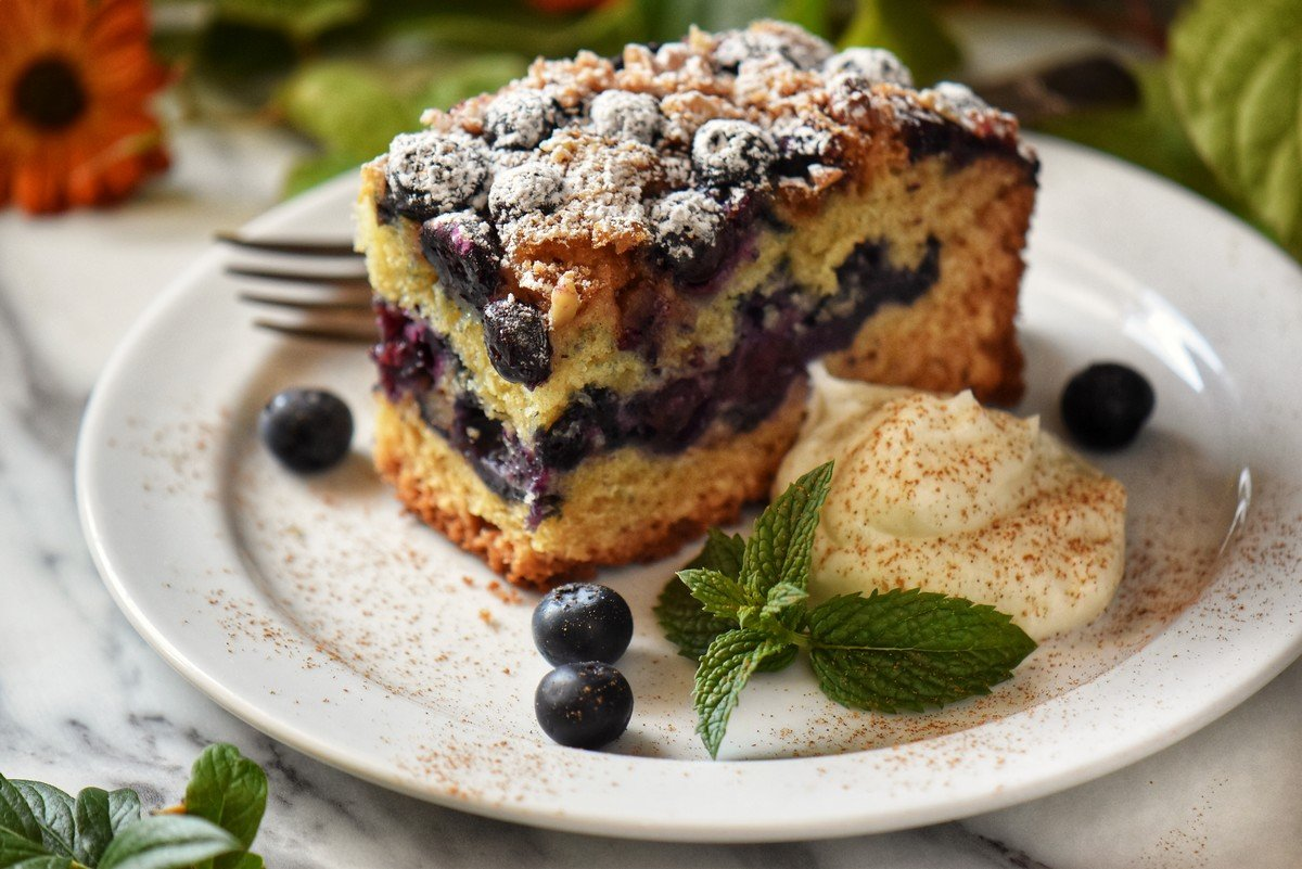 A close up of the jammy blueberry interior of a coffee cake.