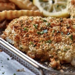 Air fryer cod on a basket.