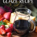 Balsamic glaze in a jar, next to fresh strawberries.