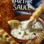 A crinkle cut fry being dipped into a no mayo tartar sauce.
