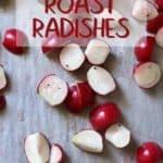 Seasoned radishes on a baking sheet ready to be roasted.