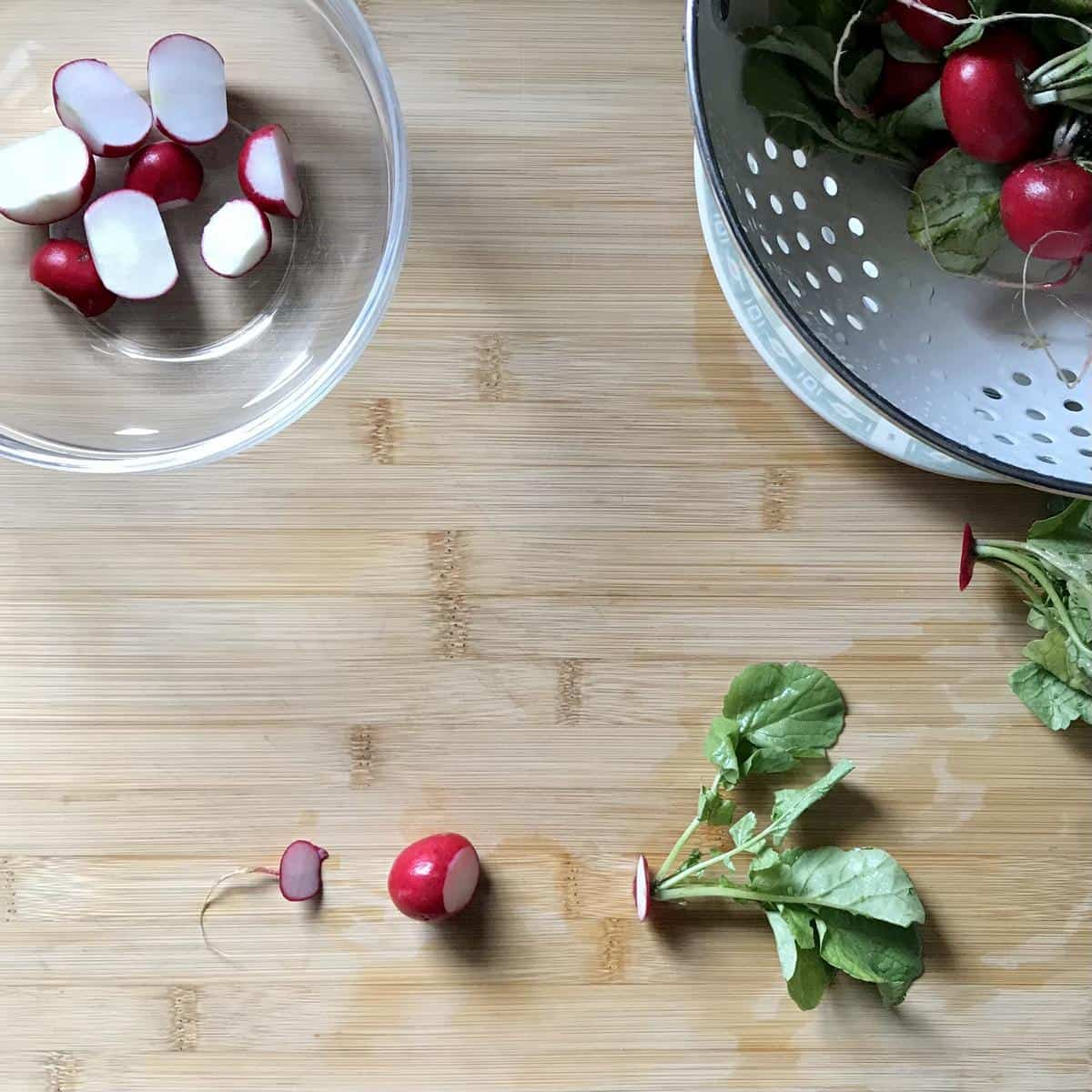 A trimmed radish on a wooden board.