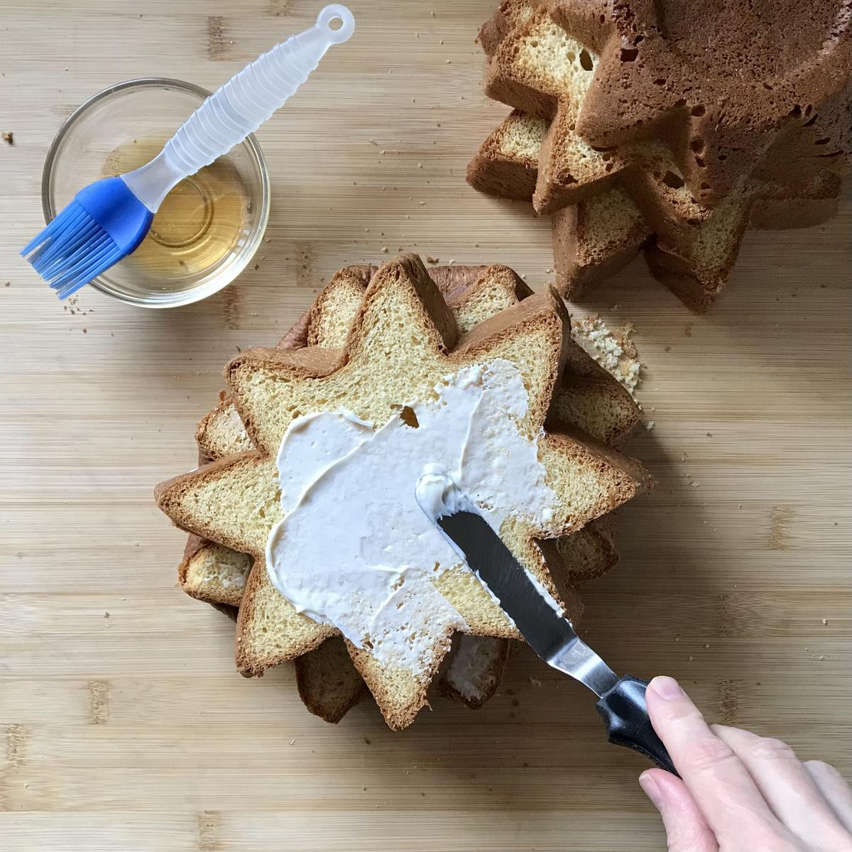 Whipped ricotta spread over the base of a pandoro cake.