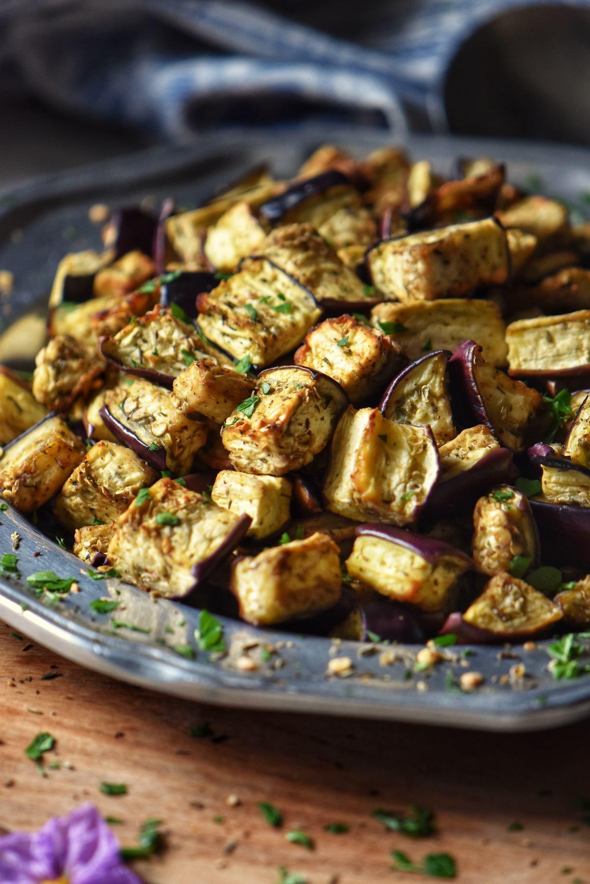 Golden air fryer eggplant on a silver platter.