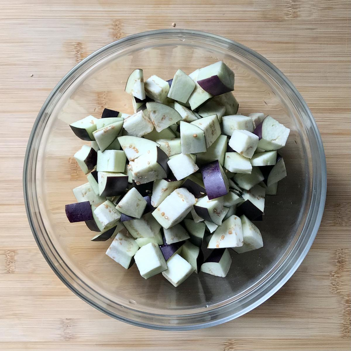 Diced eggplant in a bowl.