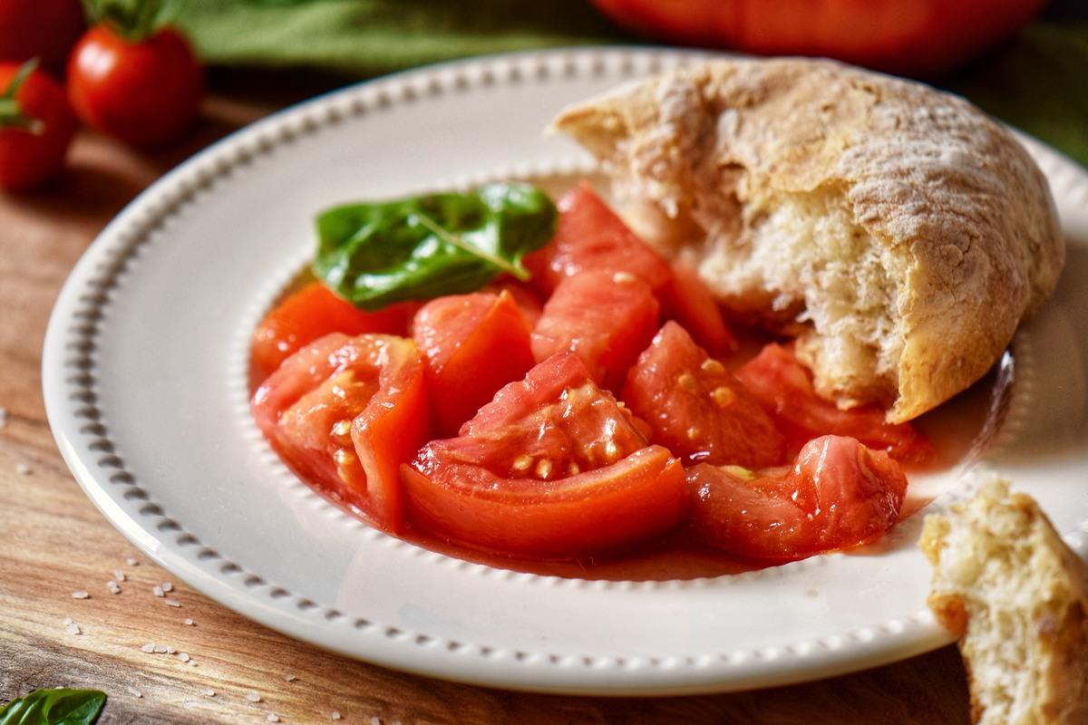 Italian tomato salad in a white plate.
