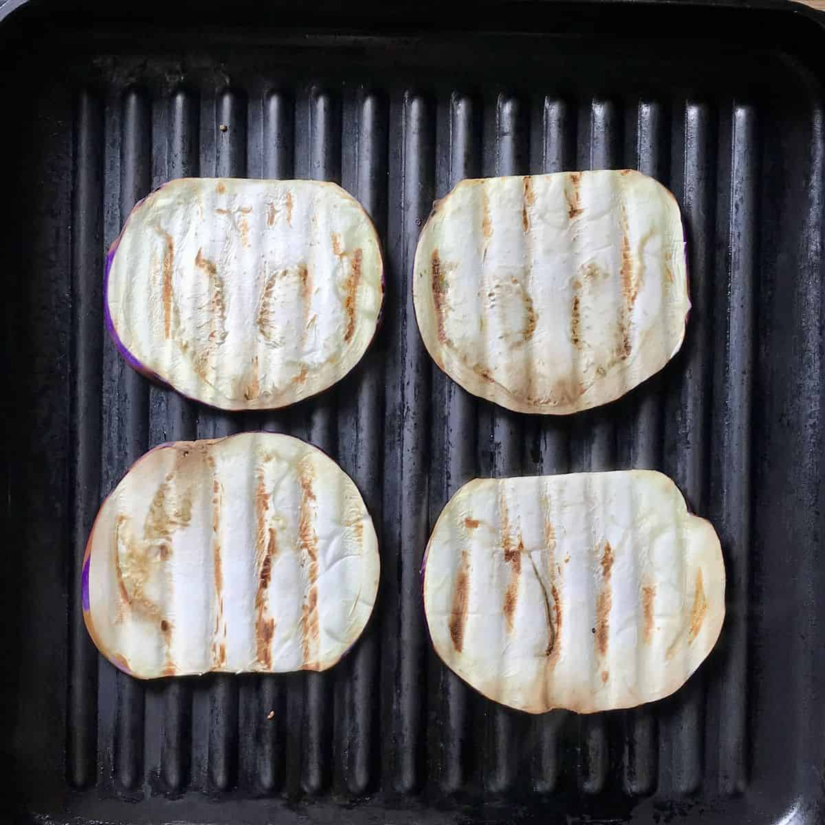 Grilling eggplants in a pan.