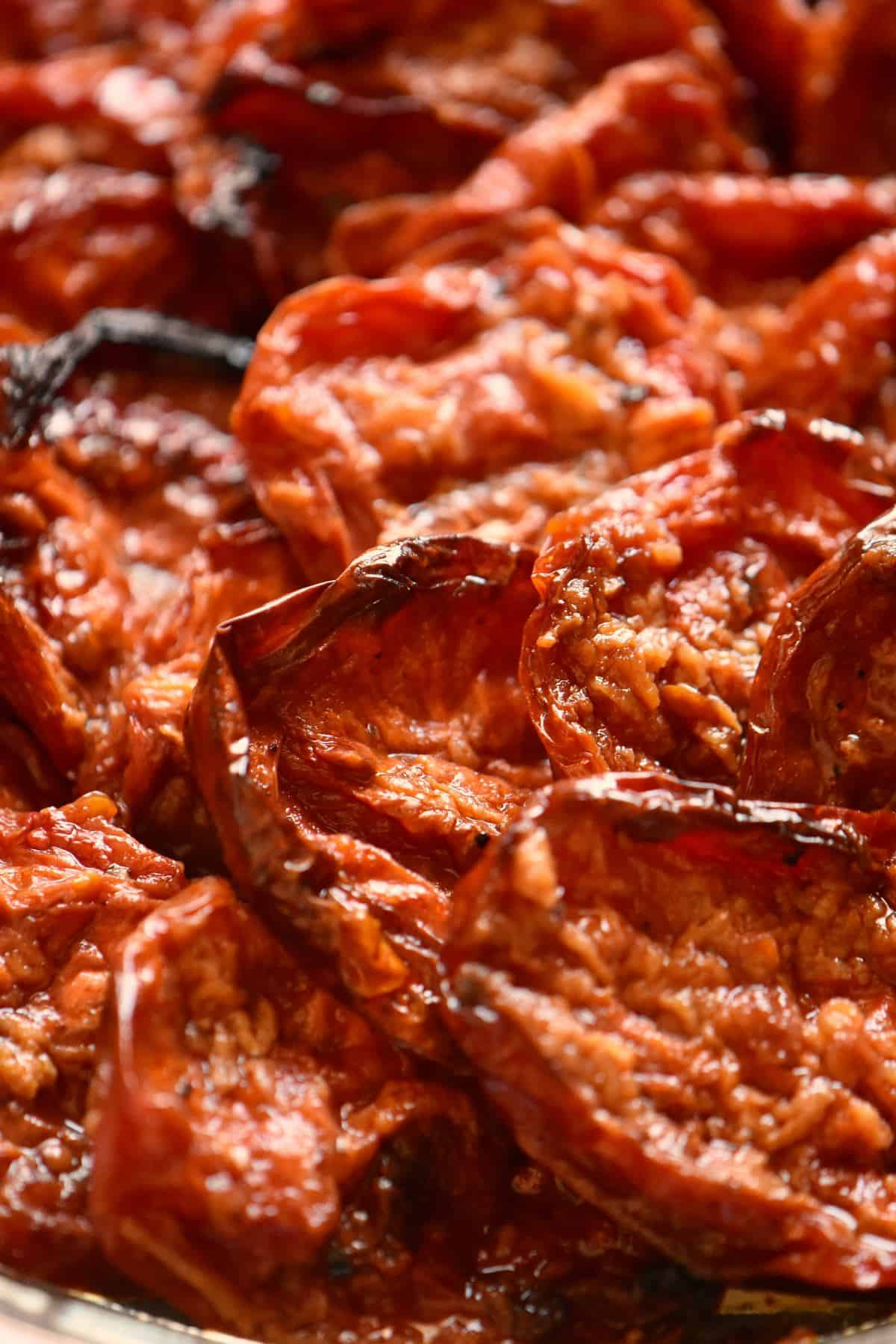 Oven roasted tomatoes on a plate.