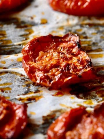 Roasted tomatoes on parchment paper.
