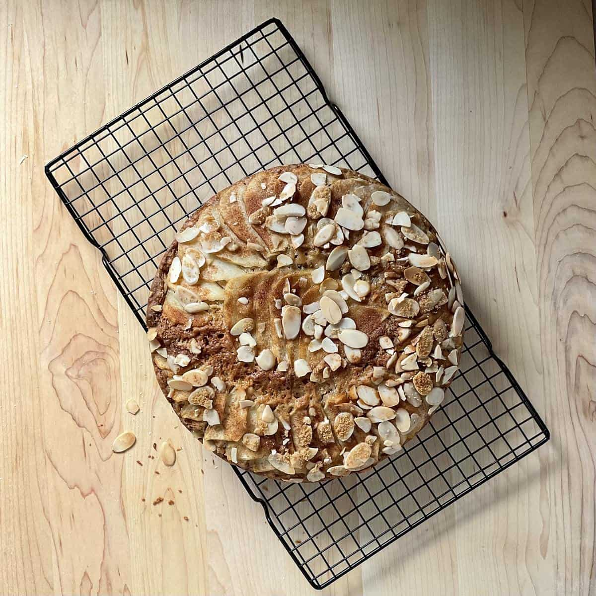 Pear cake on a cooling rack.