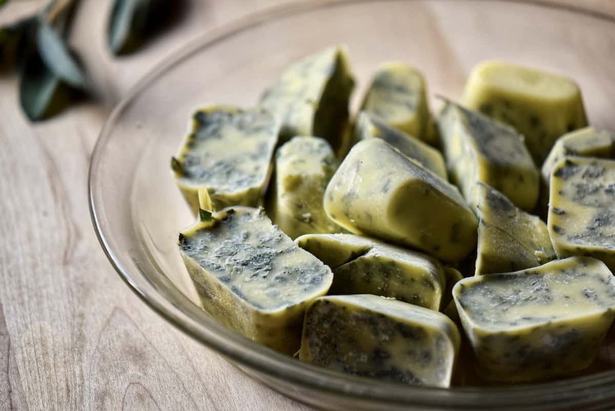 Frozen cubes of herbs on a dish.