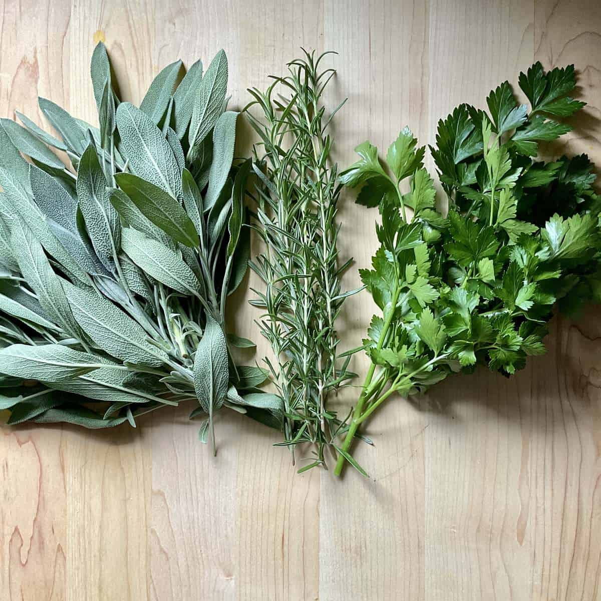 Fresh herbs on a wooden board.