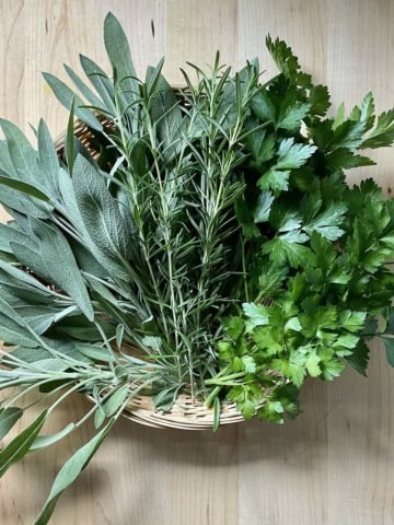 Fresh herbs on a wicker basket.